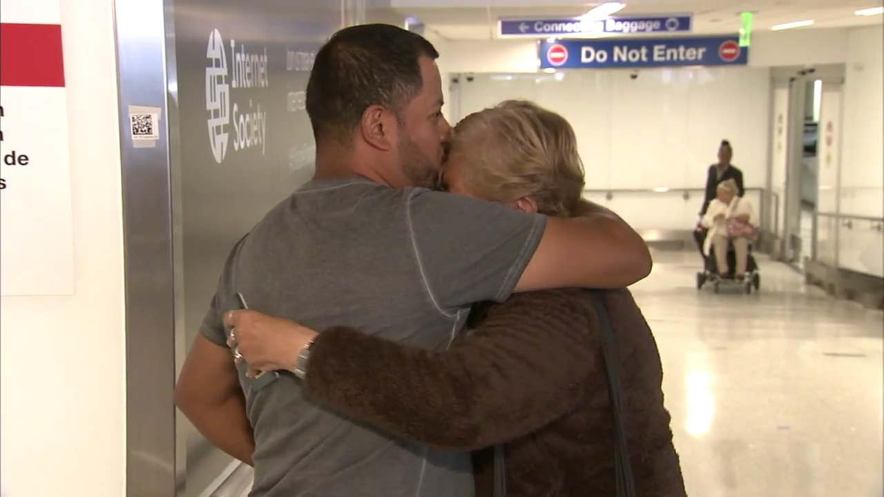 A mother and her son embrace at Los Angeles International Airport on Wednesday, Sept. 20, 2017.