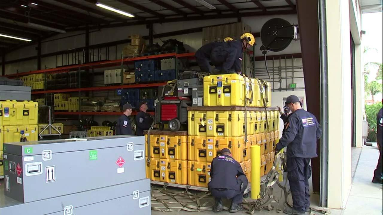 Members of Los Angeles Countys Urban Search and Rescue team prepare supplies as they await the call to possibly deploy to Mexico.