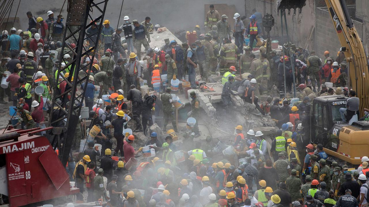 Emergency personnel search for survivors in a collapsed building in Mexico City, Mexico, Wednesday, Sept. 20, 2017.