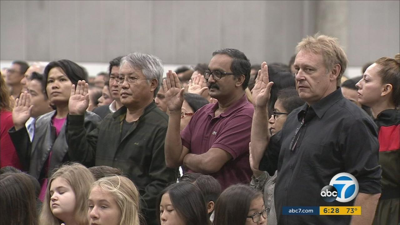 Thousands of people from more than 100 countries were sworn in as new U.S. citizens Wednesday in downtown Los Angeles.