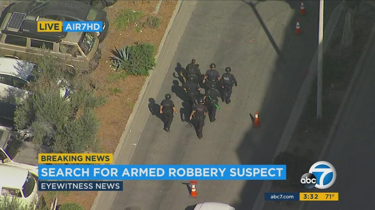 An apartment complex in Marina Del Rey was on lockdown Thursday afternoon as police searched for an armed robbery suspect after a high-speed chase, authorities said.