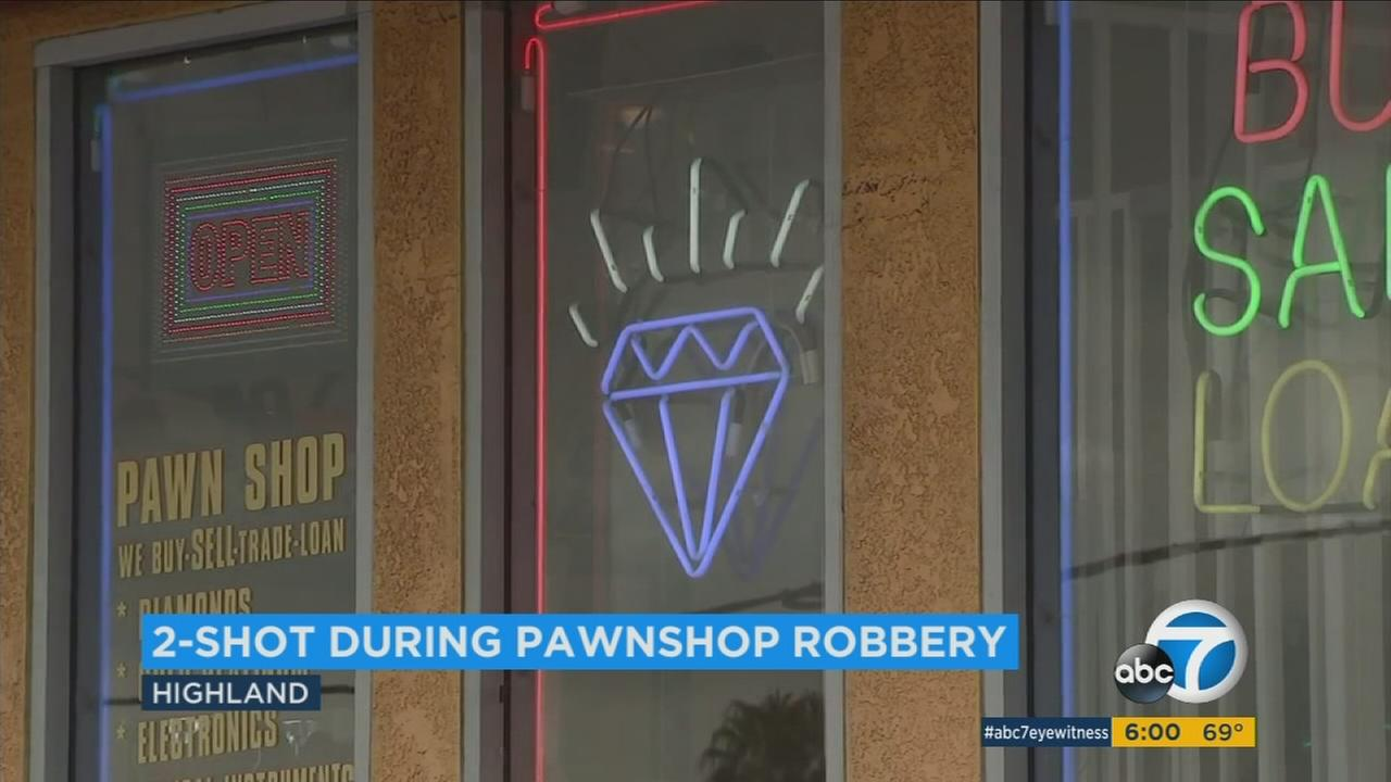 A man and woman were shot inside a pawn shop during a robbery in Highland on Thursday, Sept. 21, 2017.