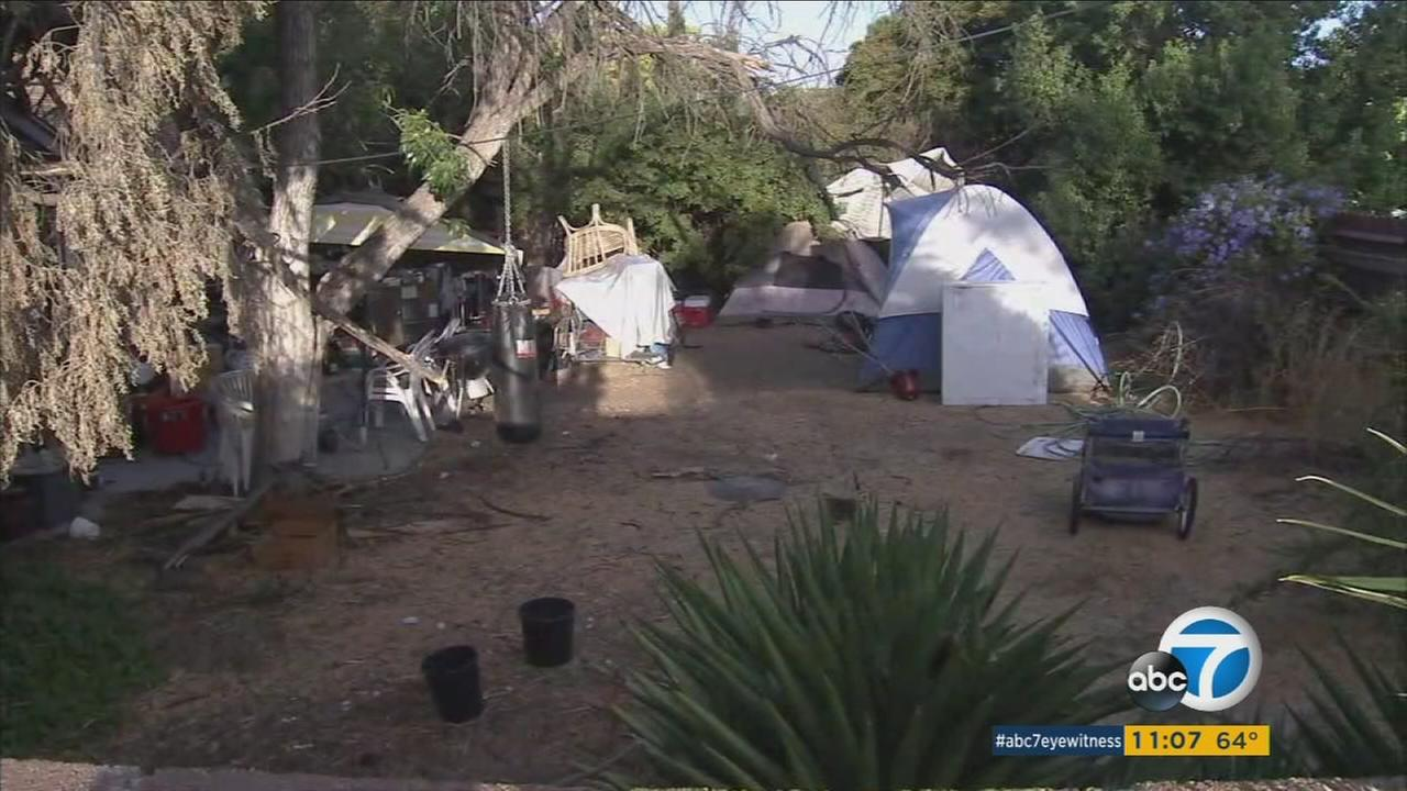 A homeless encampment in the backyard of a veterans house is shown in Granada Hills.