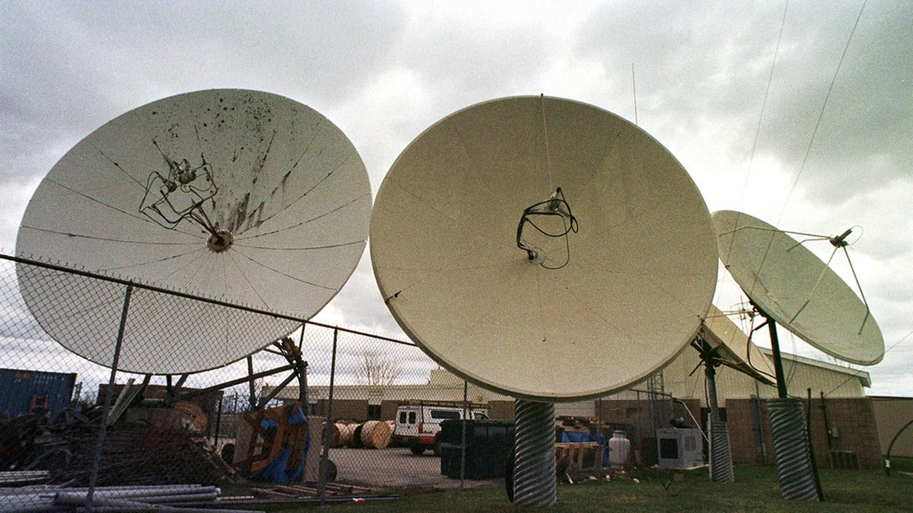 FILE--Satellite dishes point skyward at the Adelphia Communications offices in Berlin, Vt., in this April 27, 1999 photo.