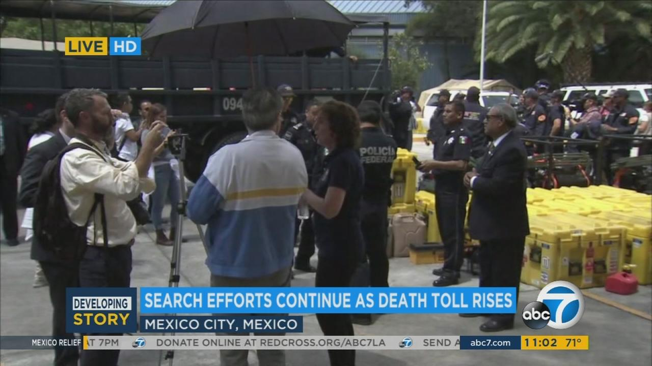 Officials gather to aid victims in the Mexico earthquake on Friday, Sept. 22, 2017.