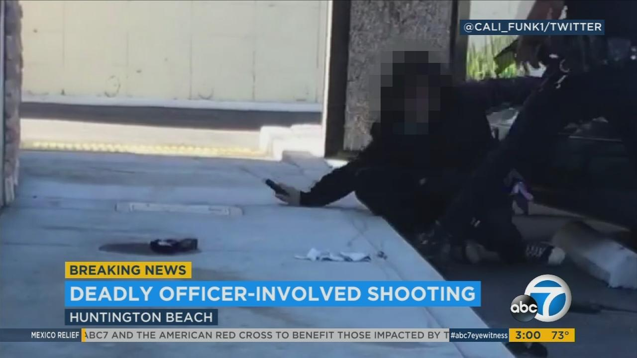 A suspect struggles on the ground with a police officer right before a shooting occurred in Huntington Beach on Friday, Sept. 22, 2017.