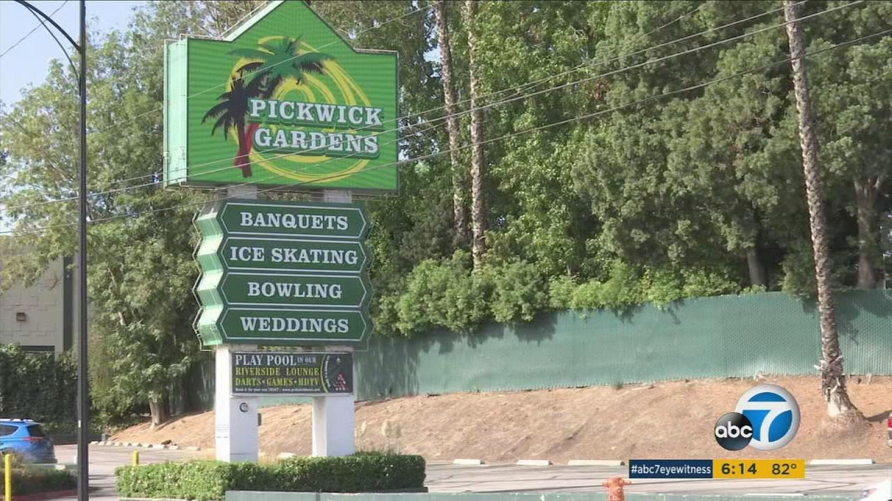 The sign and entrance to Pickwick Gardens is shown in a photo.