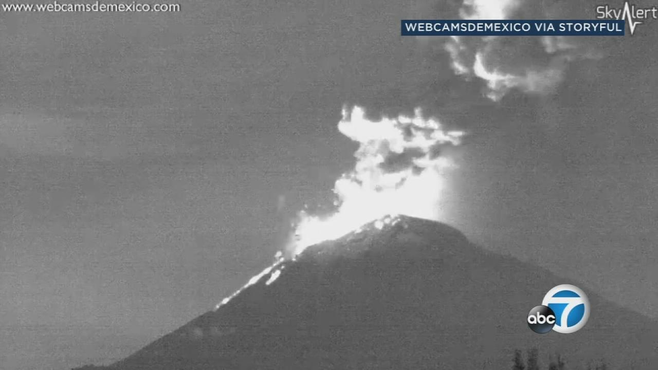 The Popocatepetl volcano outside Mexico City has spewed glowing rock and dumped ash over nearby towns.
