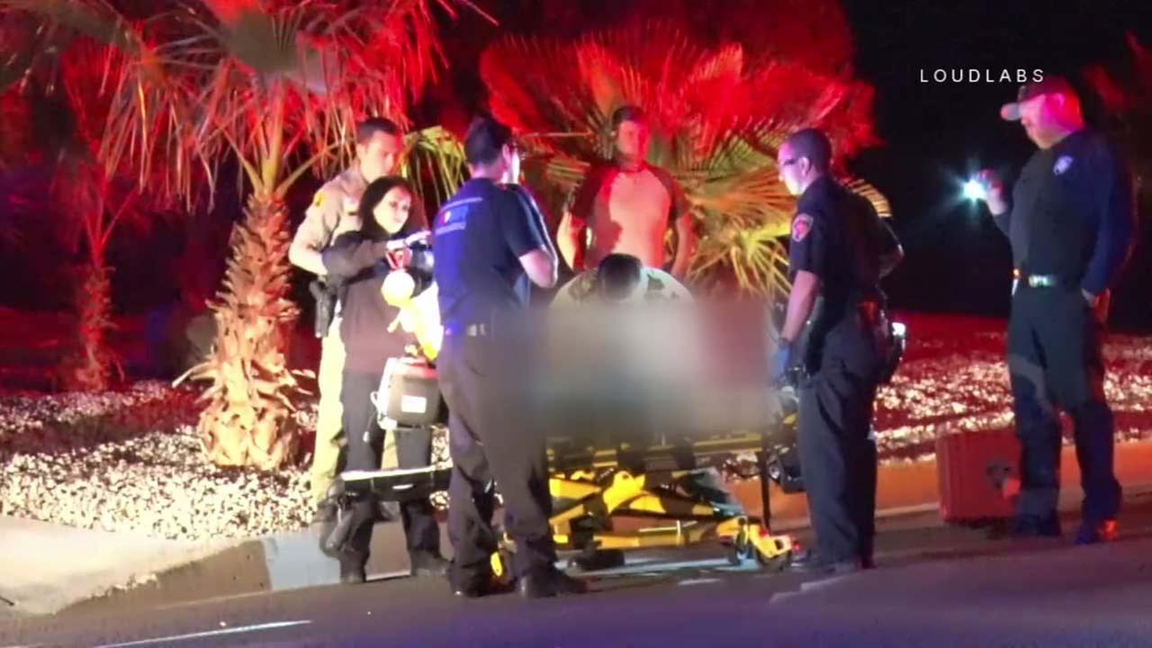 Emergency personnel surround a child who was shot in Apple Valley on Wednesday, Sept. 27, 2017.