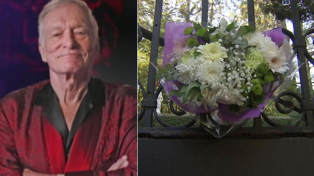 Flowers are placed at the gate of the Playboy mansion in Los Angeles on Thursday, Sept. 28, 2017, after word of Hugh Hefners passing.
