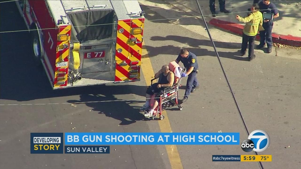 A man who was shot in the upper body with a BB gun is wheeled to an ambulance to be taken to a hospital on Friday, Sept. 29, 2017, in Sun Valley.