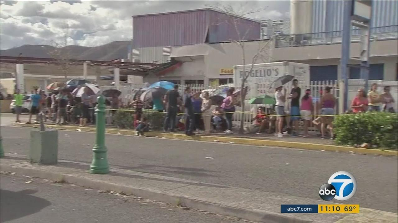 Hundreds of Puerto Ricans line up to get help and supplies as they continue to struggle with the damage left behind by Hurricane Maria.