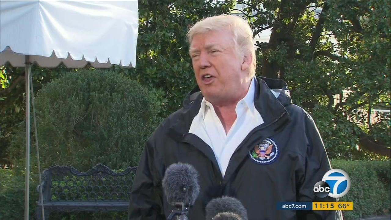 President Donald Trump came face to face with hurricane-ravaged Puerto Rico on Tuesday after denouncing critics of the federal relief effort as politically motivated ingrates.