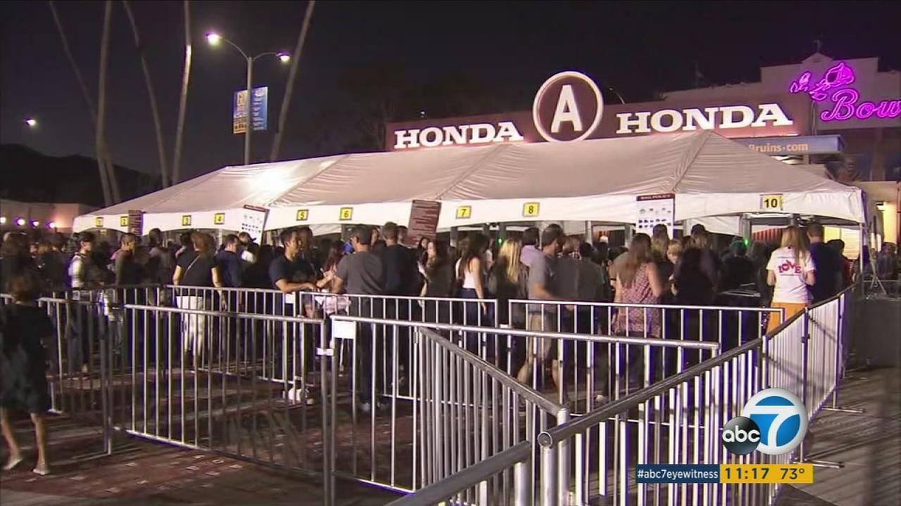 Concertgoers at the Rose Bowl in Pasadena went through metal detectors to get into the venue Friday, Oct. 6, 2017.