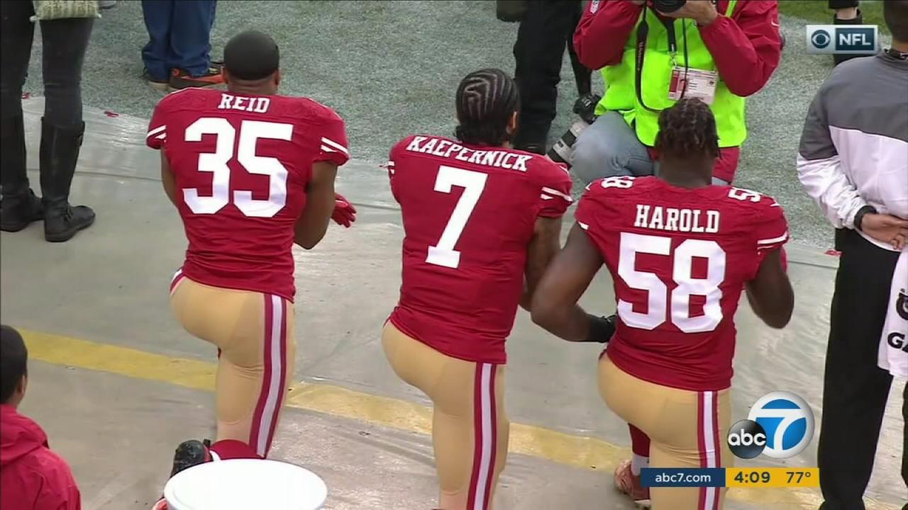 An undated photo of Colin Kaepernick kneeling during the national anthem.