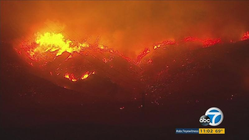 <div class='meta'><div class='origin-logo' data-origin='KABC'></div><span class='caption-text' data-credit='KABC'>The Canyon Fire 2 in Orange County continues into the night on Monday, Oct. 9, 2017.</span></div>