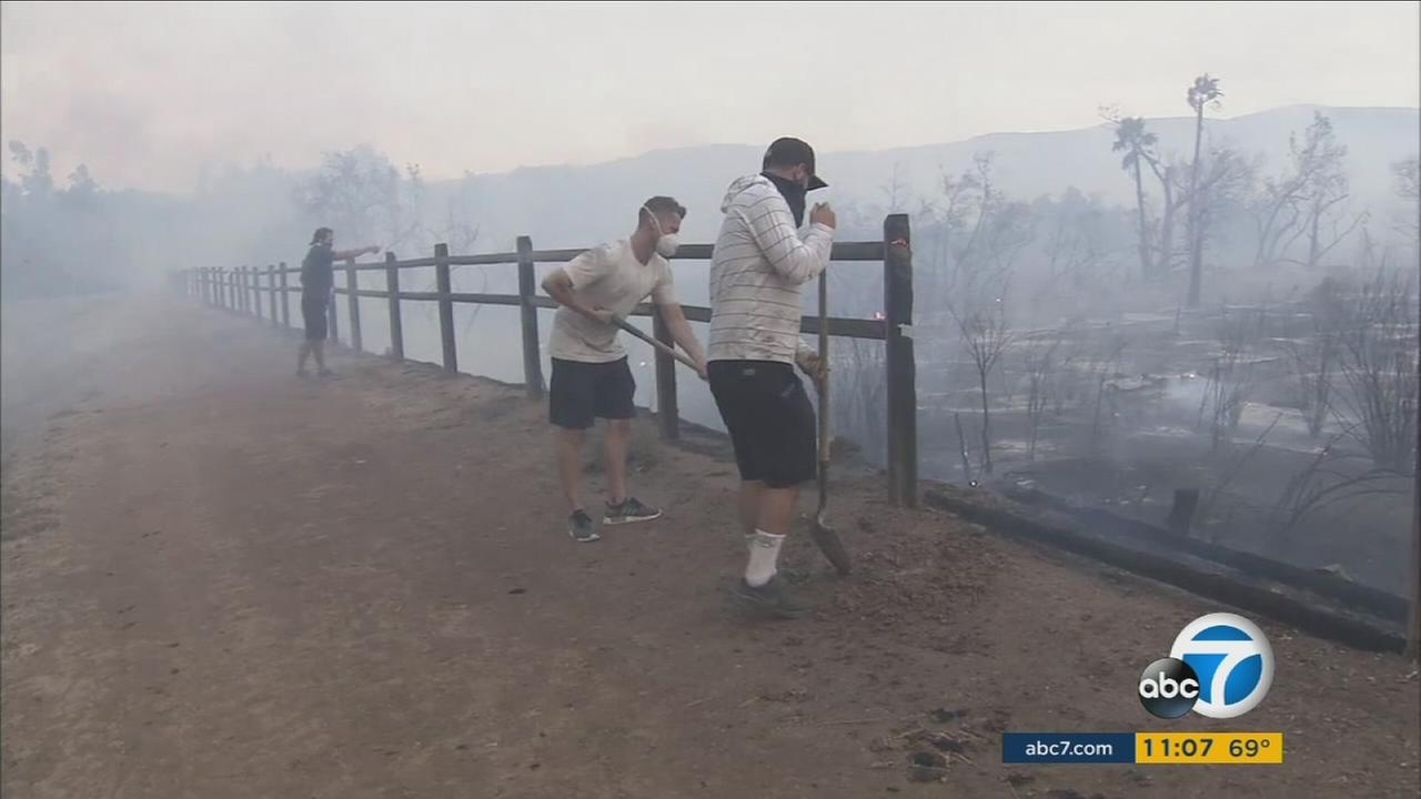 Orange County residents volunteer to work the Canyon Fire 2 after it scorched through the Peters Canyon Regional Park on Monday, Oct. 9, 2017.KABC