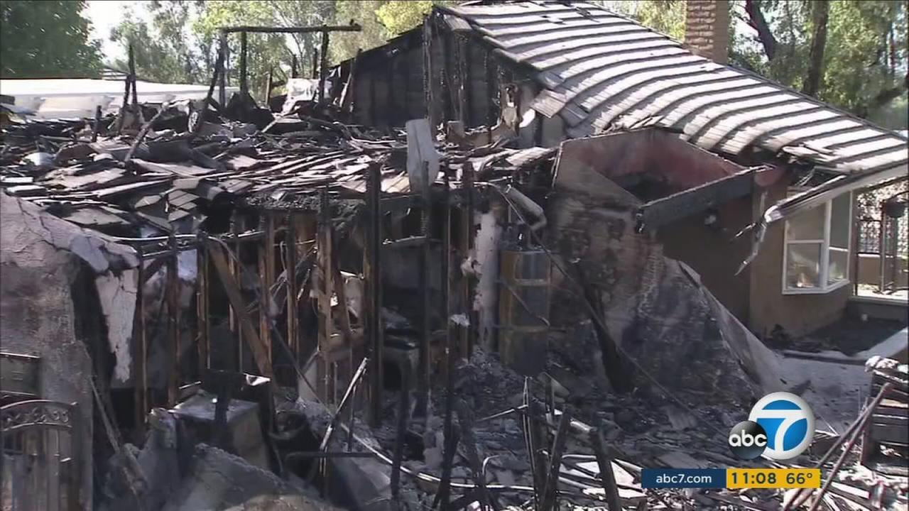 A home is fully destroyed in the Canyon Fire 2 in Orange County on Tuesday, Oct. 10, 2017.
