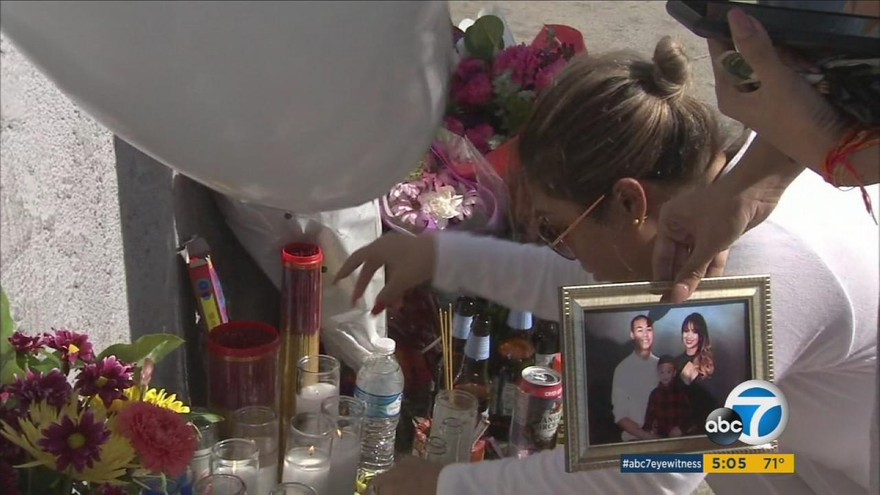 Friends and family have established a makeshift memorial at the site where two men were killed in a shooting at a Long Beach liquor store.