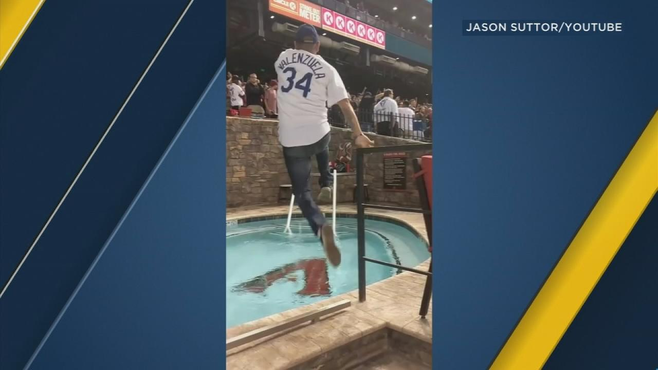 An exuberant Dodger fan celebrated the teams NLDS win with a cannonball in the Diamondbacks stadium pool.