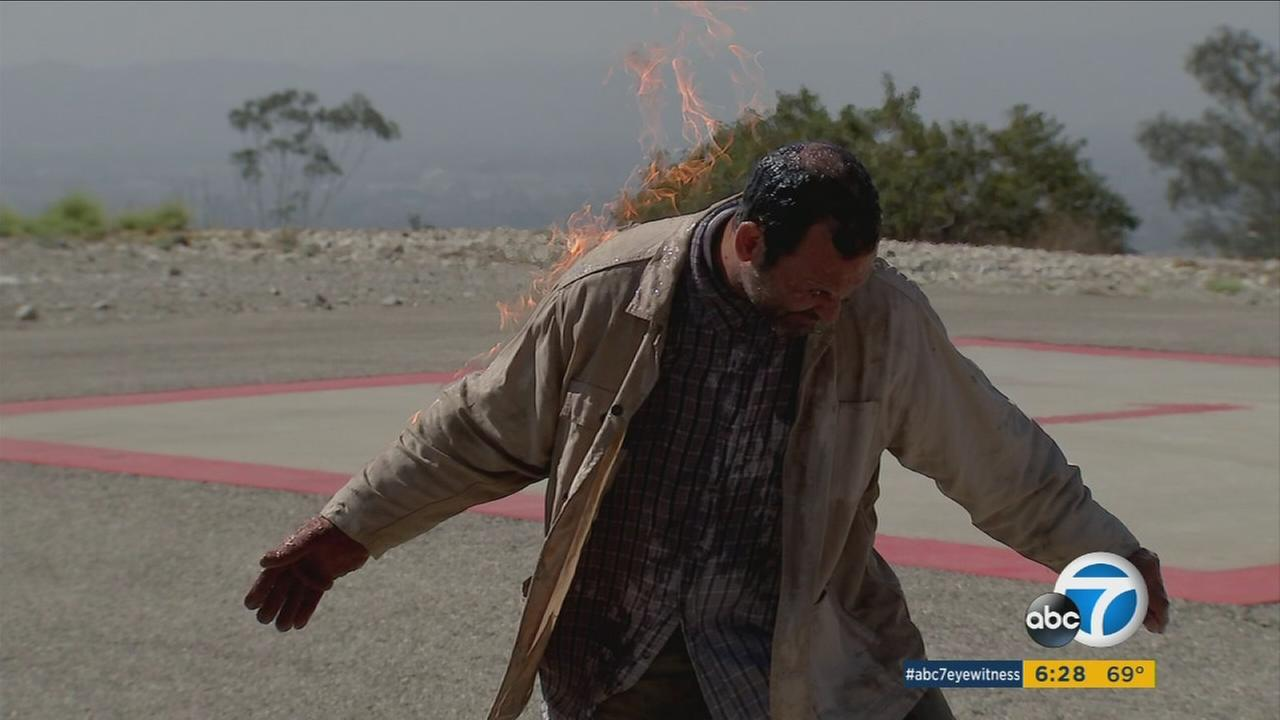 A training demonstration shows how to safely film scenes depicting a person on fire.