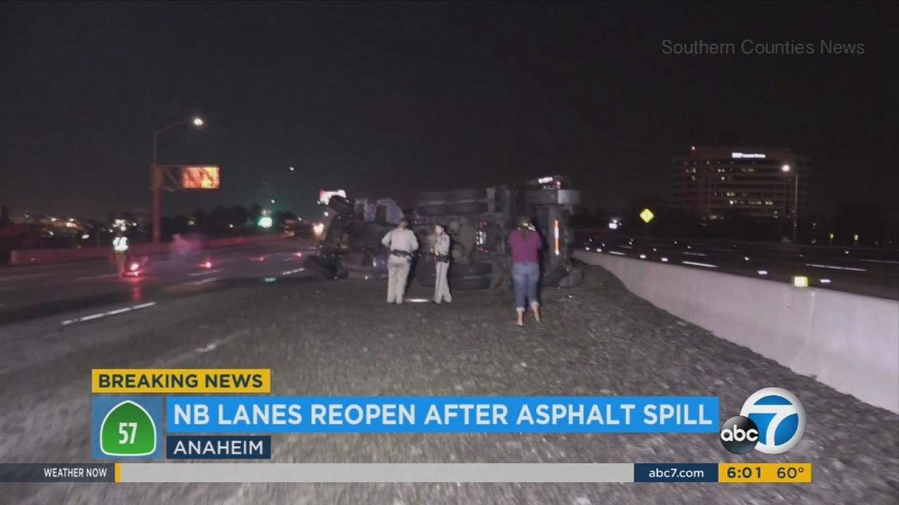 An overturned dump truck spilled its haul of asphalt across the northbound 57 Freeway in Anaheim early Friday morning, prompting the hourslong closure of several lanes.