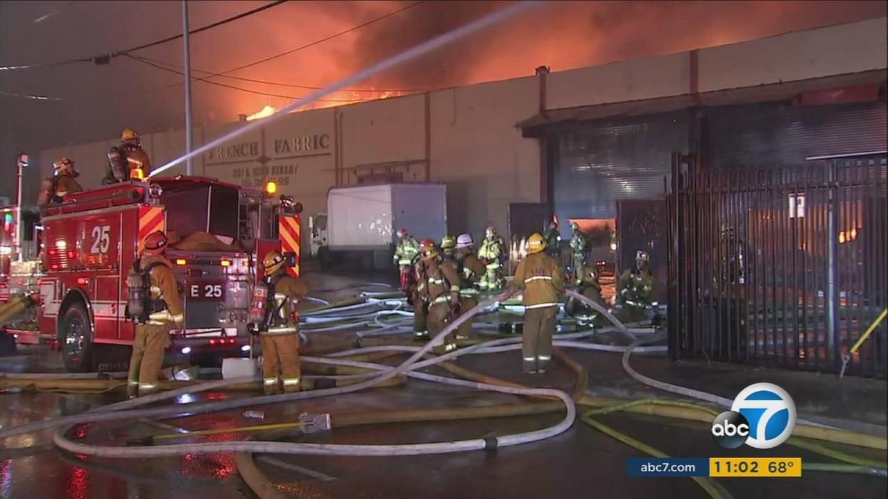 Firefighters worked to put out the blaze of a commercial building in Boyle Heights on Saturday, Oct. 14, 2017.