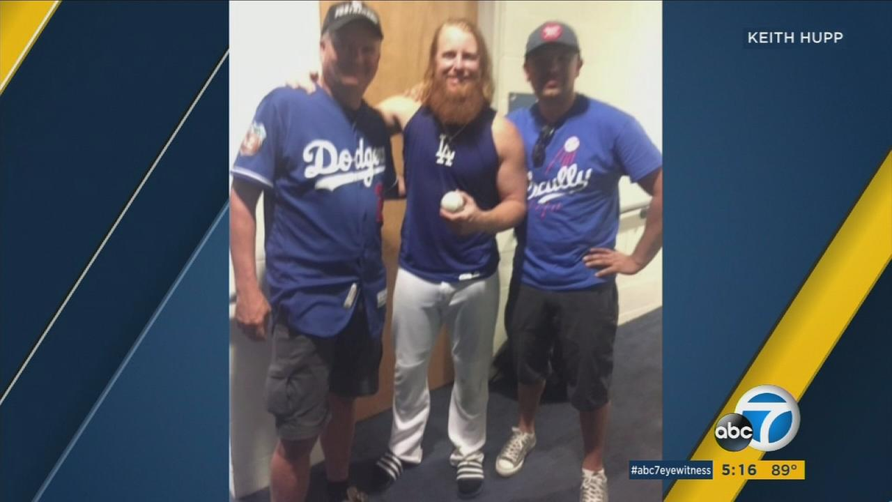 Lifelong Dodger fan Keith Hupp (left) returned Justin Turners game-winning home-run ball after Sundays NLCS Game 2.