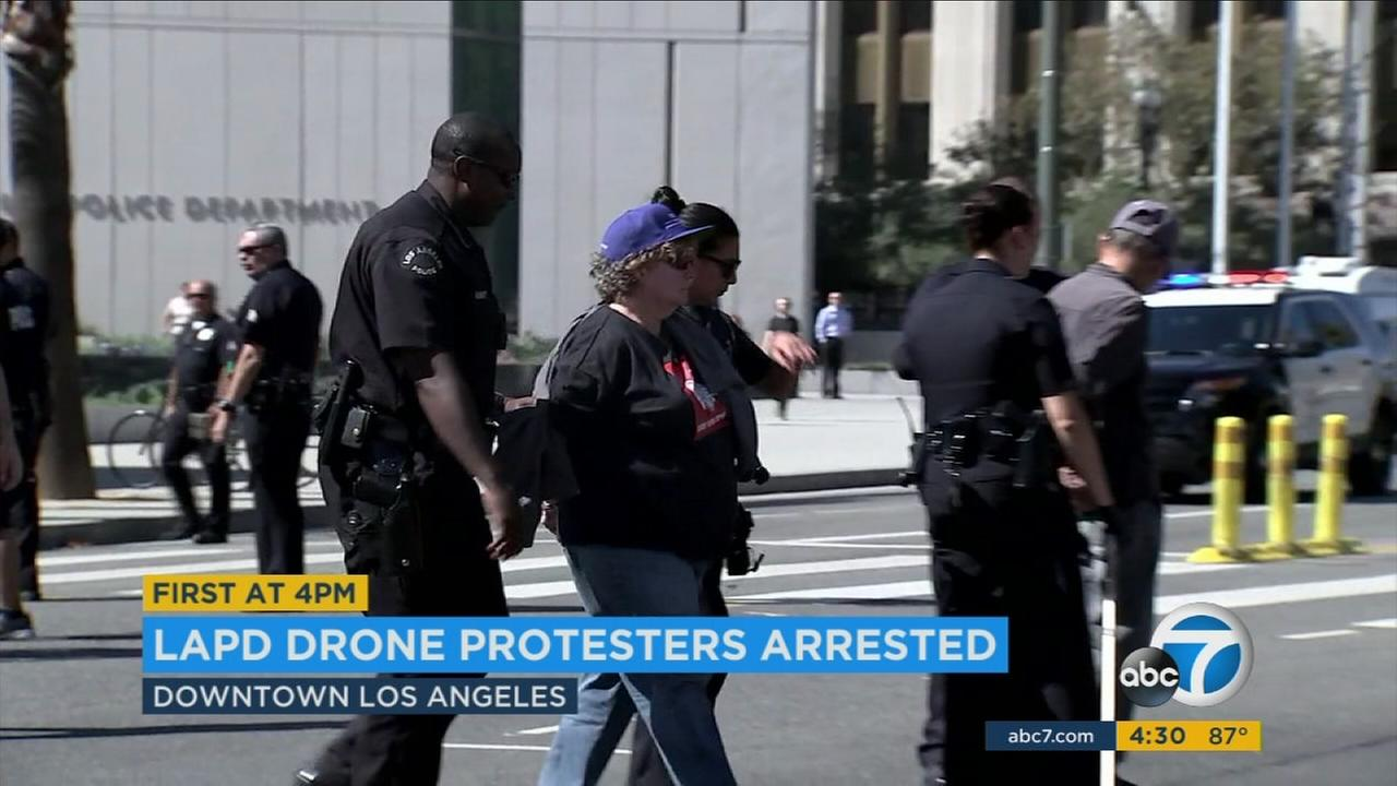 Four protesters were arrested after the Los Angeles Police Commission voted to allow the use of drones.