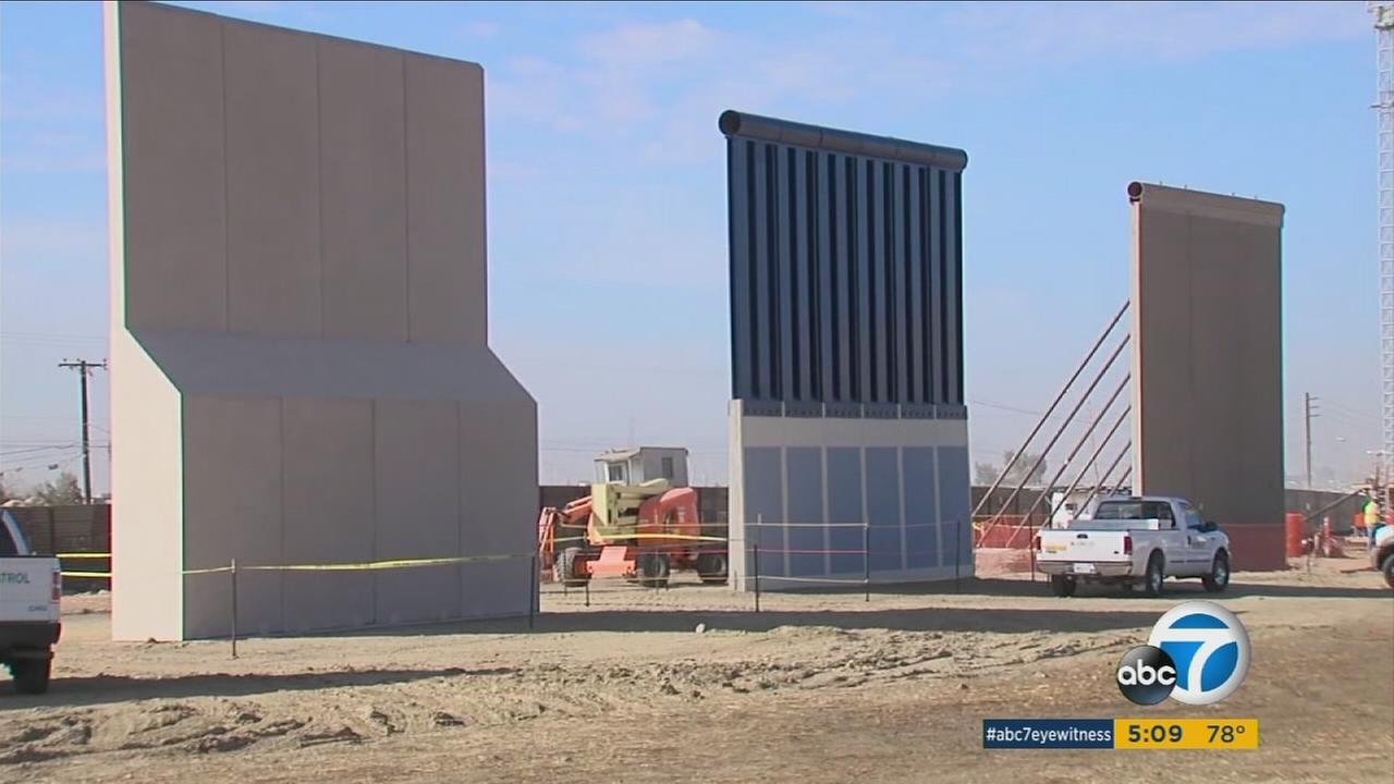 Workers are putting the finishing touches on the border wall prototypes ordered by President Donald Trump.