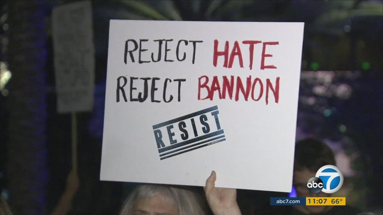 A person held up a sign that said Reject hate, reject Bannon during a protest outside of an Anaheim hotel during his state GOP convention speech on Friday, Oct. 20, 2017.