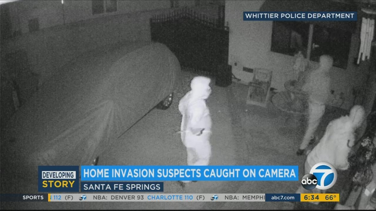 An elderly resident was forced to the ground by intruders during a home invasion that was partially captured on surveillance video in Santa Fe Springs, authorities said.