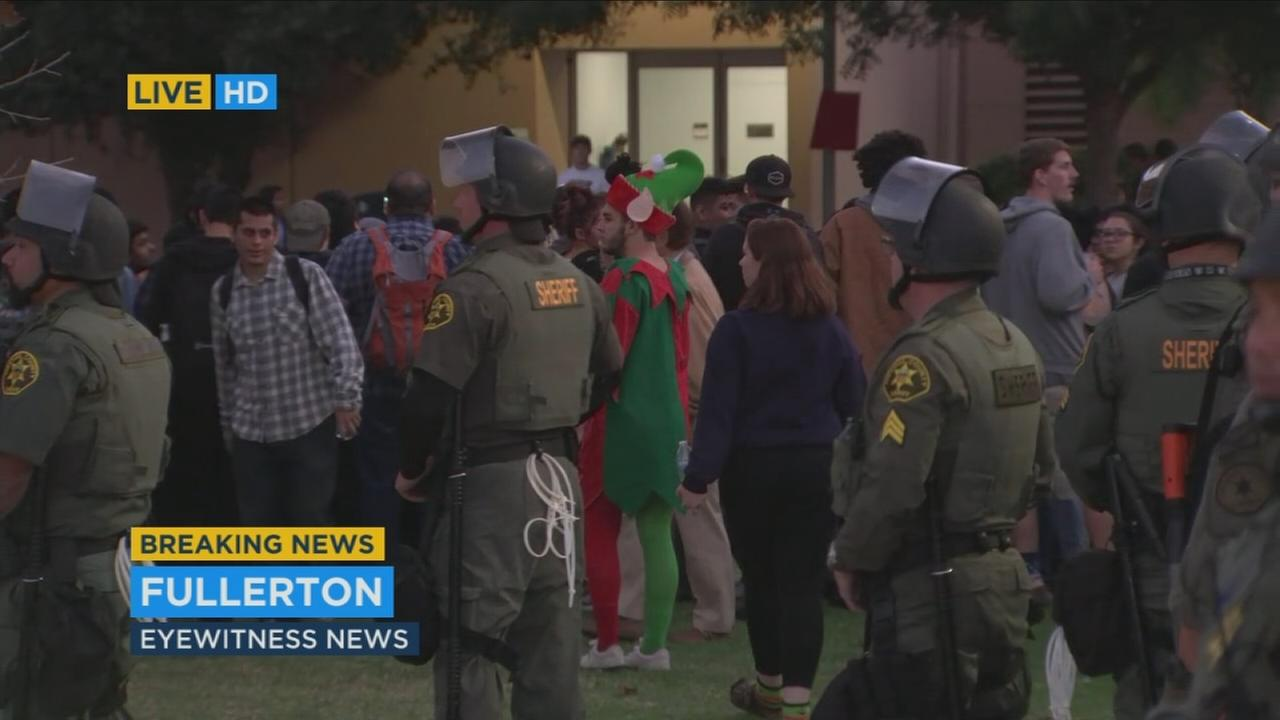 Seven protesters were arrested outside a venue on the California State Fullerton campus where controversial conservative provocateur Milo Yiannopoulos was slated to speak Tuesday night, according to the university.