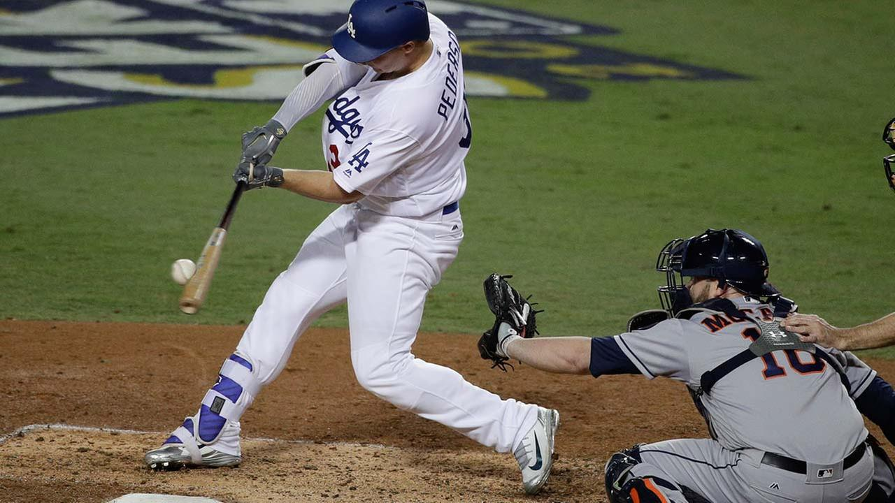 Los Angeles Dodgers Joc Pederson hits a home run against the Houston Astros during the seventh inning of Game 6 of baseballs World Series Tuesday, Oct. 31, 2017, in Los Angeles.