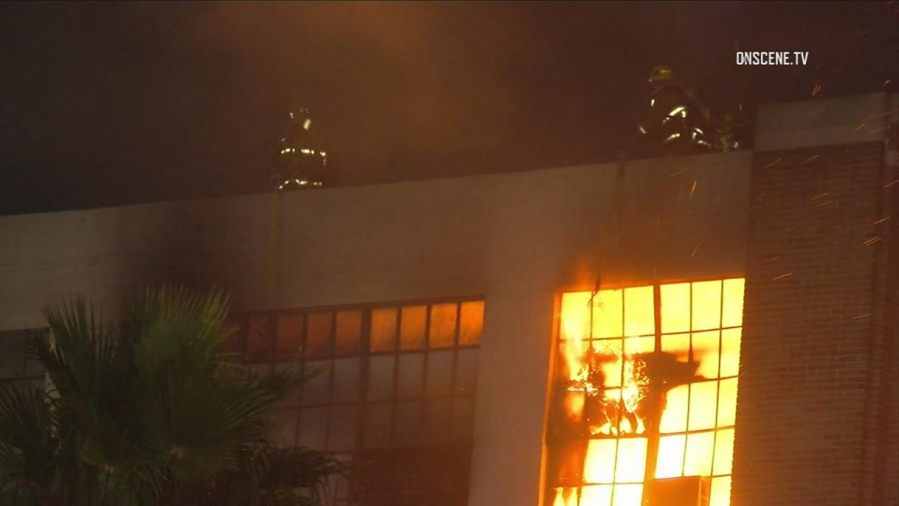 A dramatic fire ripped through the upper floor of a four-story commercial building Monday, Nov. 6, 2017, in downtown L.A.s Fashion District.
