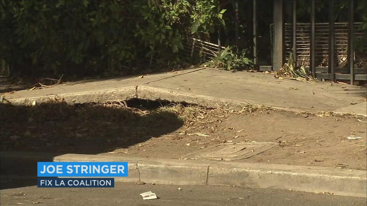 South Los Angeles residents and several community groups say the city has broken its promise to fix their sidewalks.