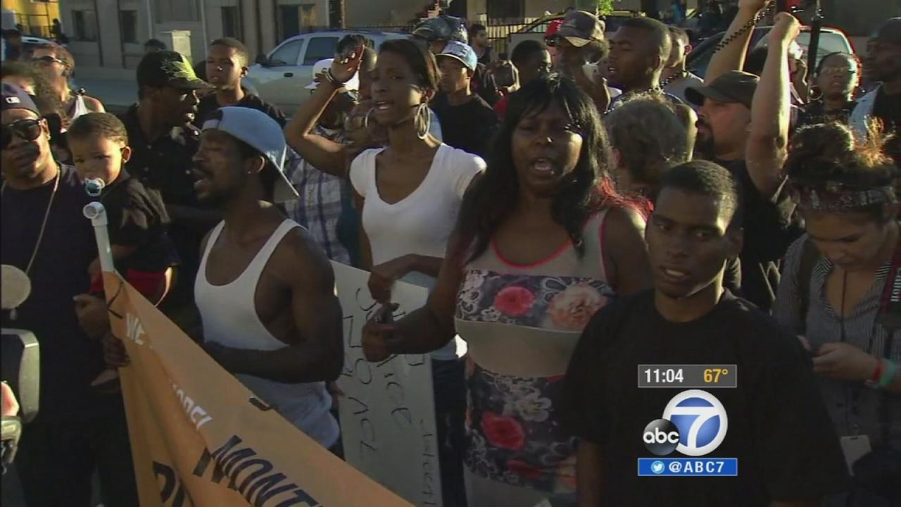 Family and community members protest the fatal police shooting of a South Los Angeles man on Thursday, Aug. 14, 2014.