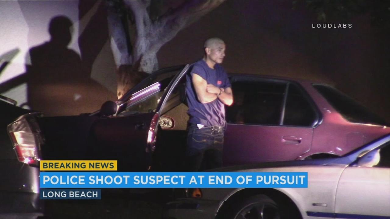 A 27-year-old carjacking suspect was in custody late Wednesday evening after police shot him with less-than-lethal rounds at the end of a pursuit in Long Beach, authorities said.
