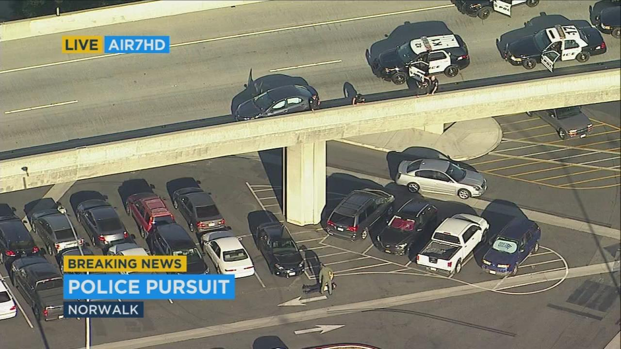 A suspect who was being chased by police on the 605 Freeway in Orange County jumped from a freeway overpass.