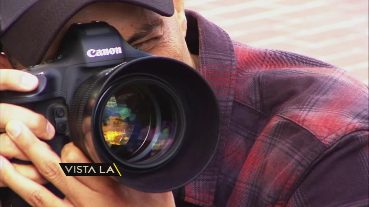 Photographer Javier Castellanos is shown taking a photo of a Mexican immigrant who was working in Santa Ana.