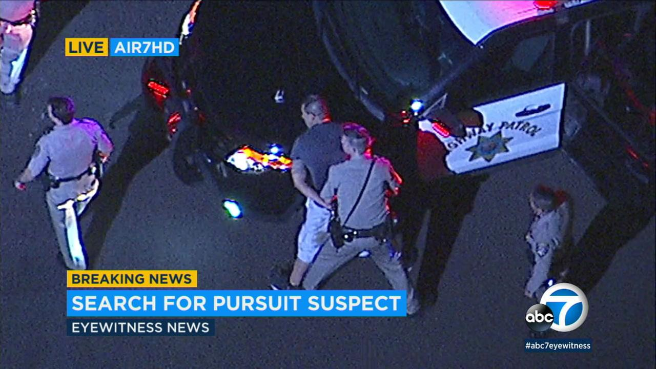 A chase suspect is taken into custody in San Pedro on Friday, Nov. 10, 2017.