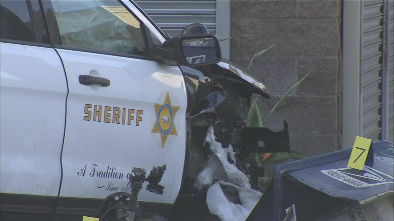 A damaged Los Angeles County Sheriffs Department SUV is shown in a photo.