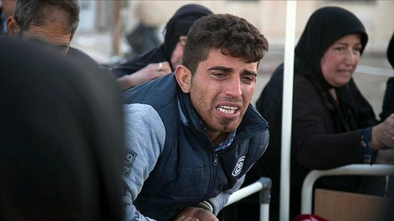 A grieving man is seen near the Iran-Iraq border a powerful earthquake struck the area.