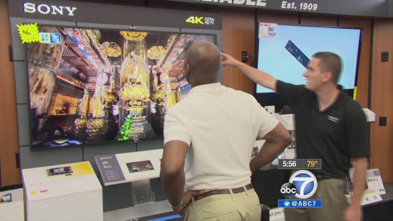 A shopper looks at an Ultra HD TV.