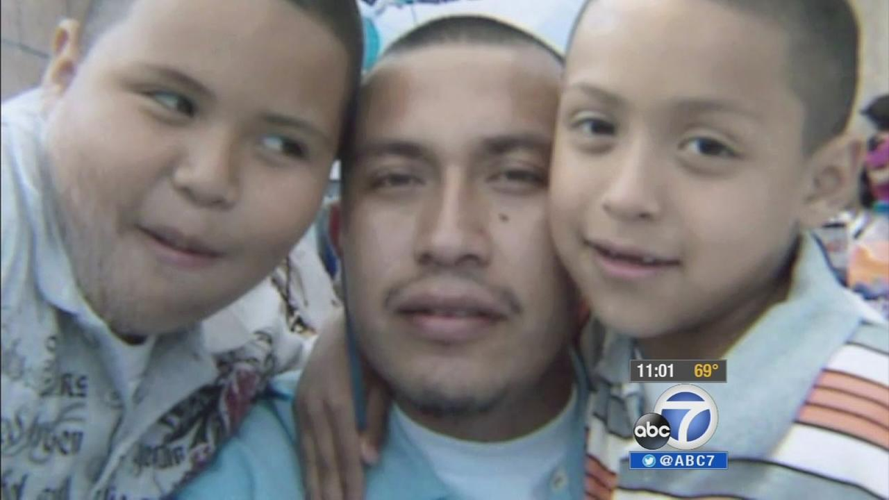 Omar Abrego, 37, is shown with his two children in this undated file photo.