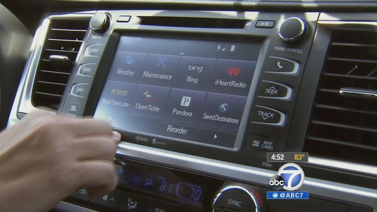 A hand touches a digital dashboard in a car in this undated file photo.