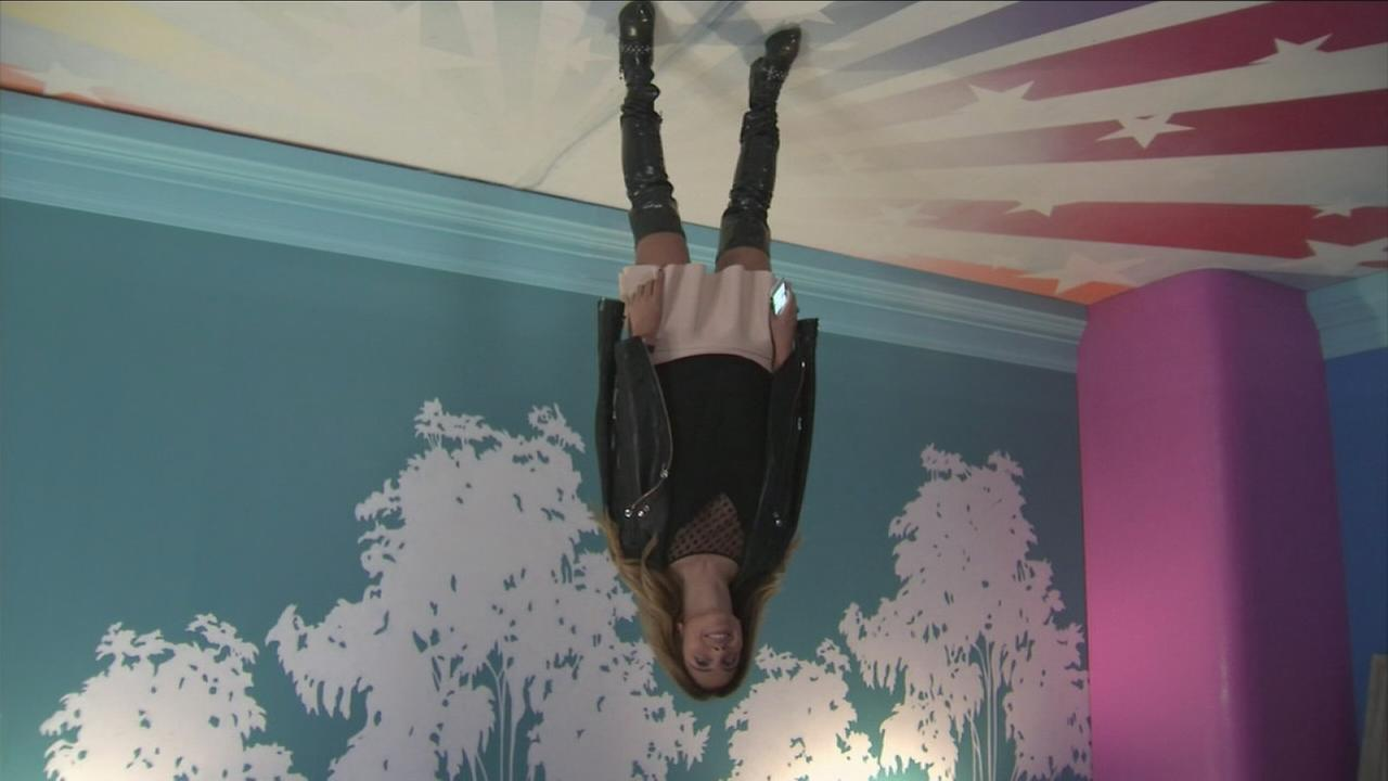You can take a upside-down photo standing on the ceiling of a bedroom at the Happy Place in downtown Los Angeles.