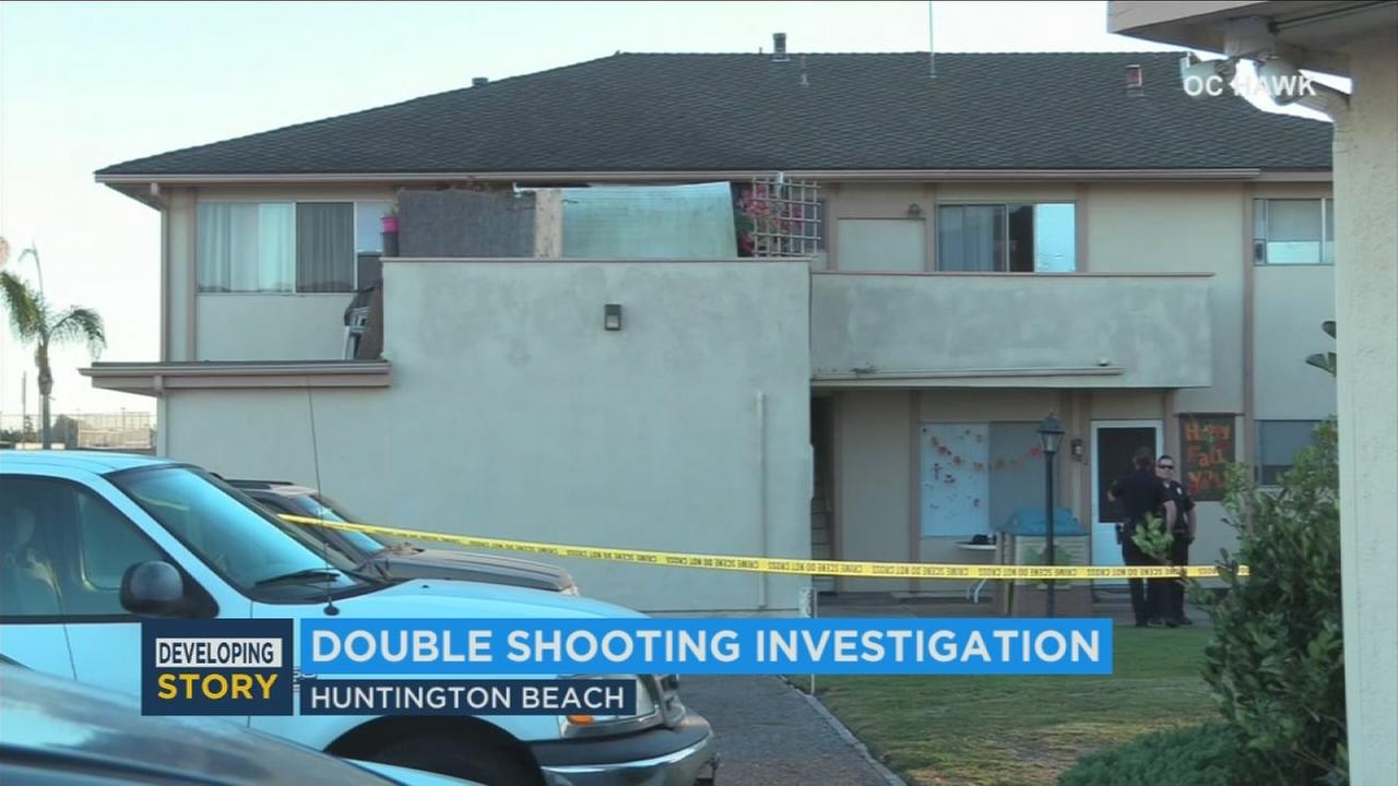 Authorities searched a crime scene after two brothers in their 20s were found shot to death in Huntington Beach on Sunday, Nov. 19, 2017.