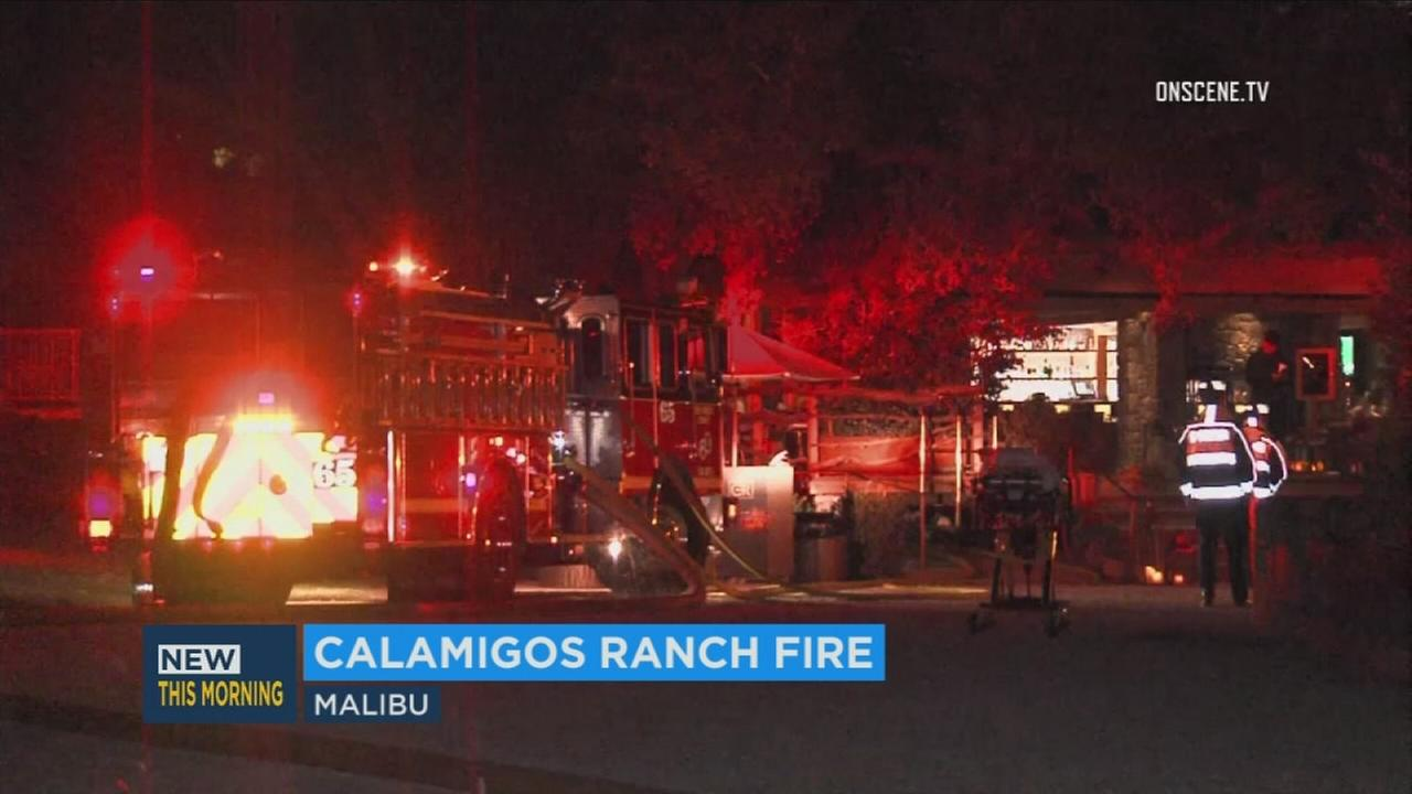 LA County Fire Department firefighters knock down a blaze at Calamigos Ranch in Malibu on Monday, Nov. 20, 2017.