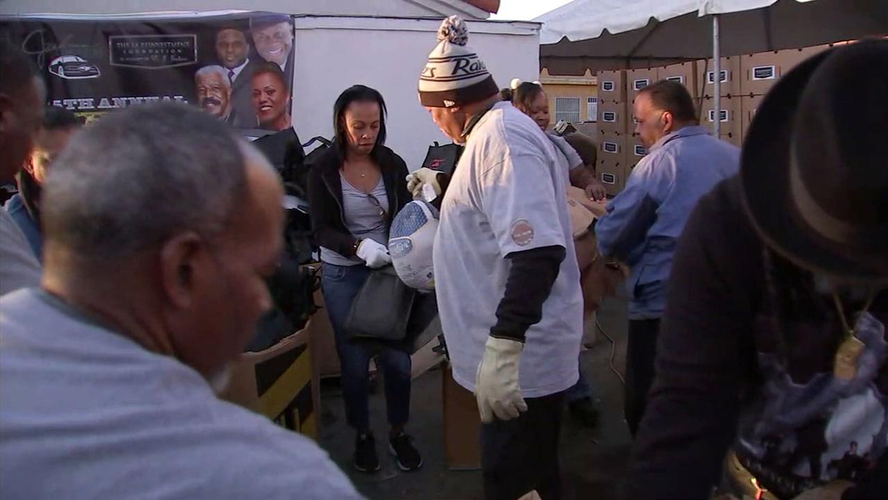 Volunteers help Jackson Limousine Service hand out 12,000 turkeys and fixings for Thanksgiving on Tuesday, Nov. 21, 2017.